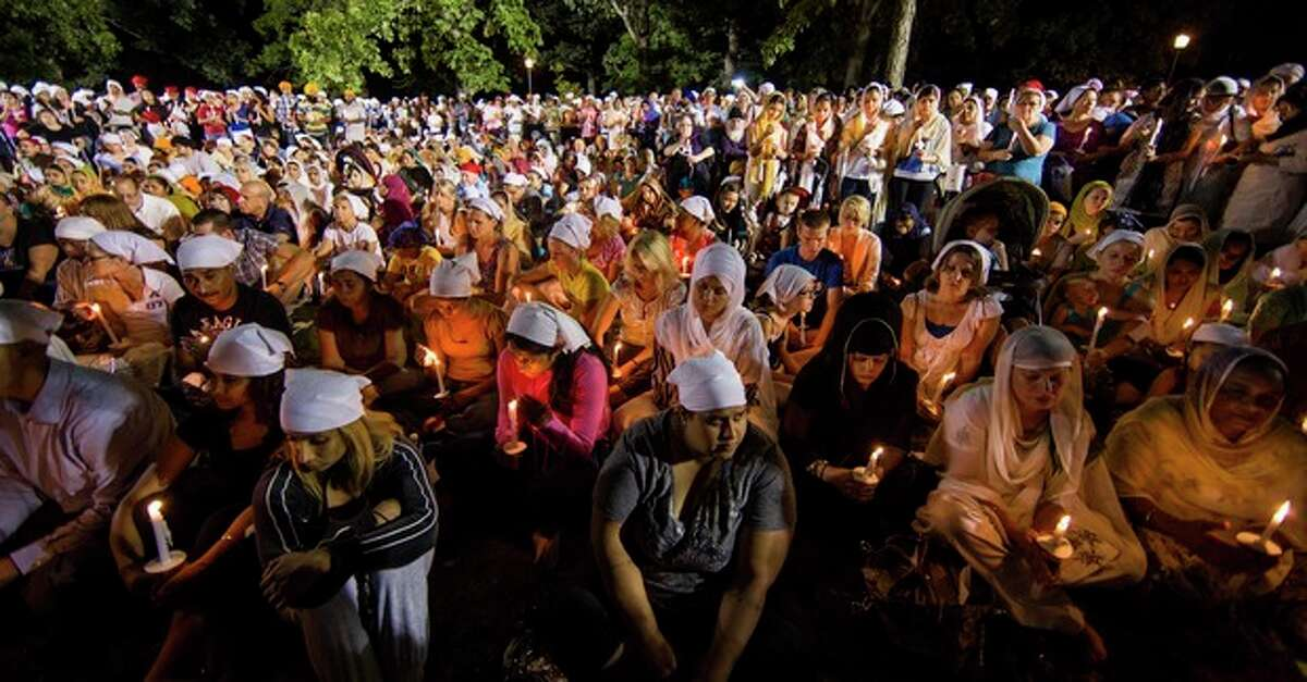 A candle light vigil is held Tuesday Aug. 7, 2012, in Oakr Creek, Wis., for the victims of a mass shooting at the Sikh Temple of Wisconsin on Sunday. The vigil was held during the national night out event at the Oak Creek Civic Center. (AP Photo/Tom Lynn)