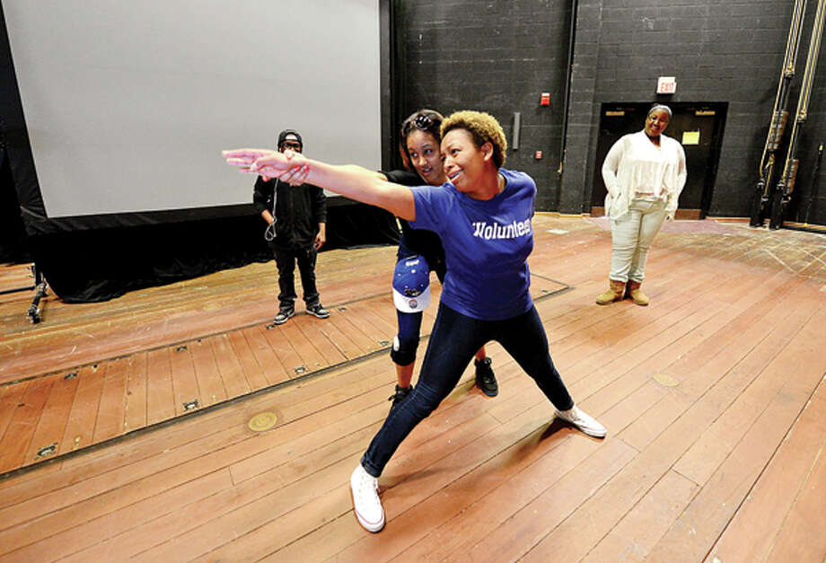Brien McMahon High School senior Desiree Davis works with Norwalk Community College student volunteer Saige Bryan in a improvisational theater excercise as NCC hosts NCC Live Thursday where high school students get to take mini-courses like criminal justice, exercise science, culinary arts, theater, marketing, physical therapy and social media. Hour photo / Erik Trautmann / (C)2013, The Hour Newspapers, all rights reserved