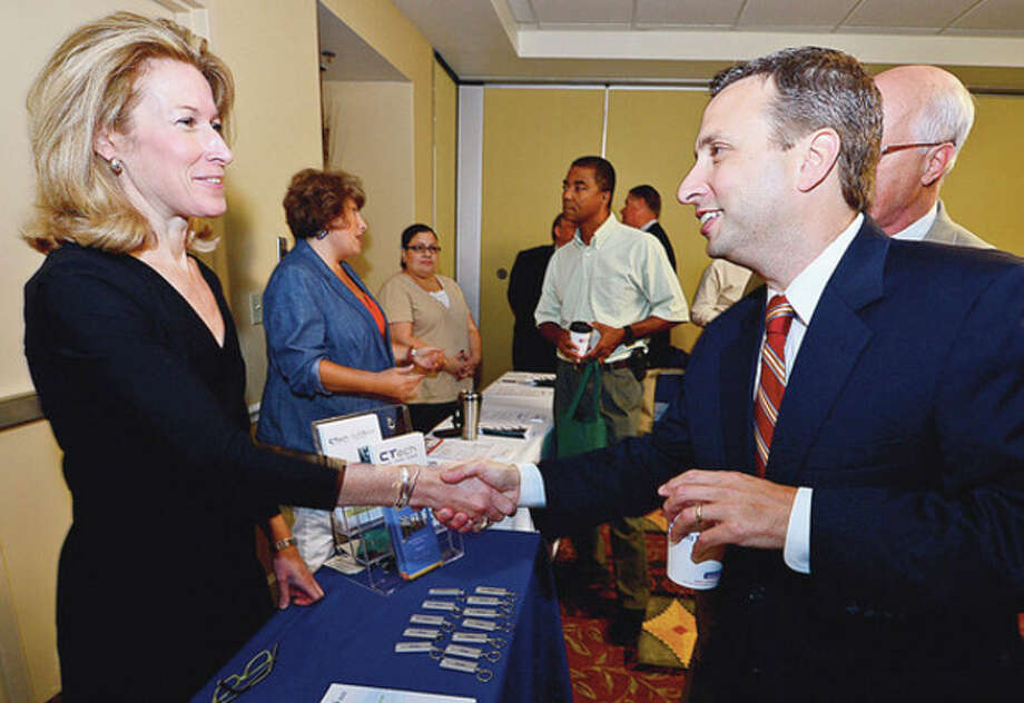 CT Innovations Marketing ManagerPamela Hartley chats with State Senator Bob Duff (D-Norwalk) during the Small Business Expo State hosted by the senator and the Greater Norwalk and Darien Chambers of Commerce Wednesday at the Hilton Garden Inn.Hour photo / Erik Trautmann / (C)2012, The Hour Newspapers, all rights reserved