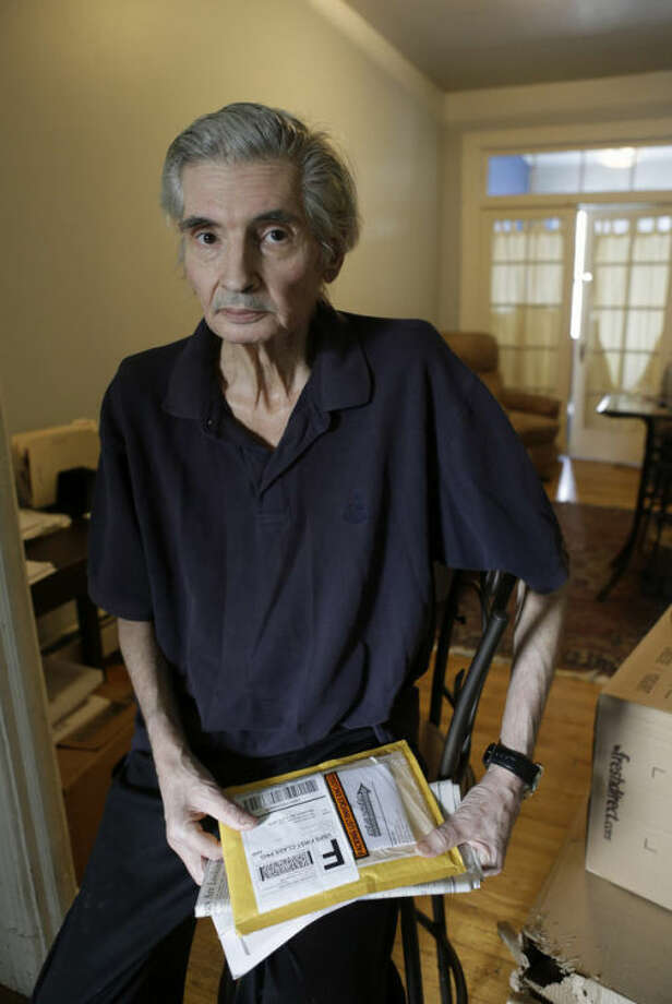 Michael Claes, 62, who contracted a superbug while in the hospital, poses for a photograph while recovering at home in New York, Monday, April 8, 2013. Claes caught a bad case of a diarrheal illness caused by Clostridium dificile, while he was a kidney patient last fall at New York City's Lenox Hill Hospital. (AP Photo/Kathy Willens)