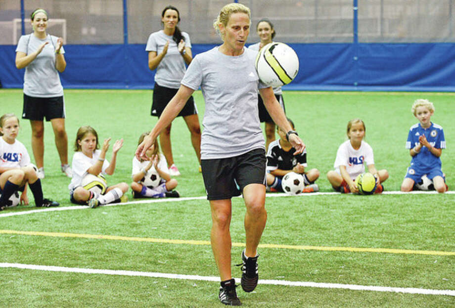 Hour photo/Erik TrautmannKristine Lilly, former member of U.S. Women's Olympic soccer team, conducts her soccer camp at the indoor soccer facility at Chelsea Piers in Stamford Wednesday. A three-time Olympian, Lilly helped win two gold medals and a silver. / (C)2012, The Hour Newspapers, all rights reserved