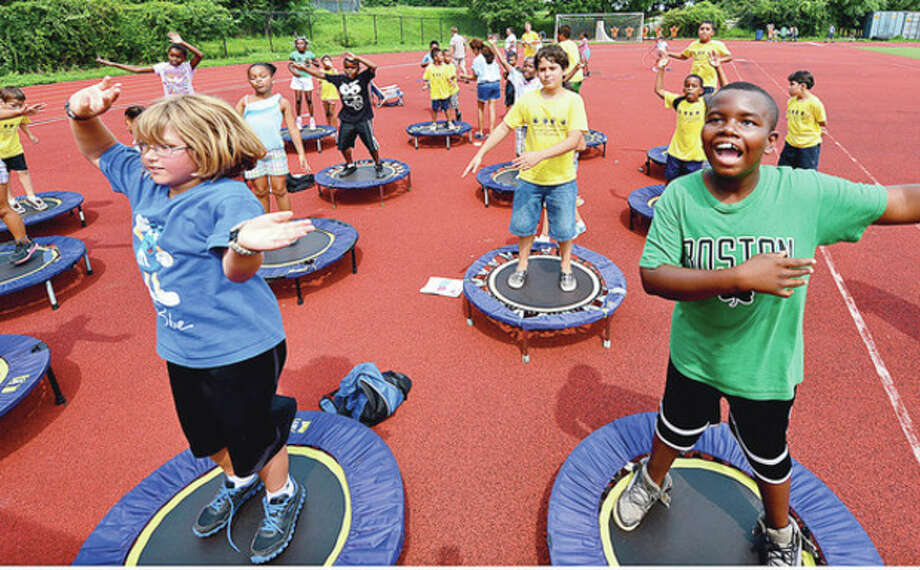 Hour photo/Erik TrautmannCampers participate in rebounding during the second annual Chelsea Cohen Fitness Academy Jamboree Wednesday at Westhill High School. More than 500 summer camp kids took part in the jamboree. / (C)2012, The Hour Newspapers, all rights reserved