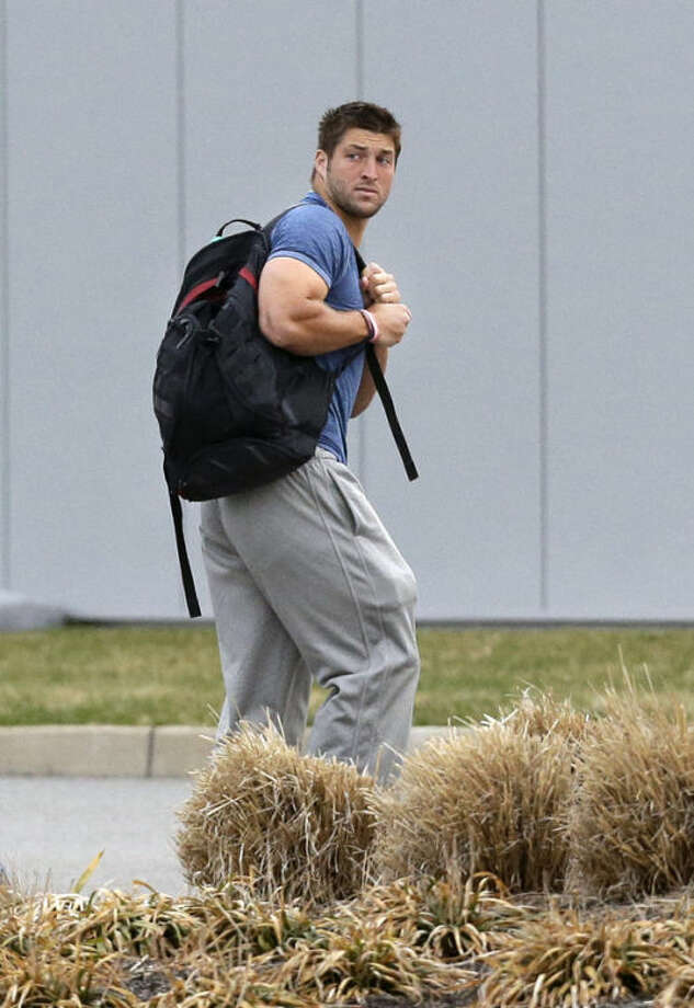 FILE - In this Monday, April 15, 2013 file photo, New York Jets quarterback Tim Tebow arrives on the first day of NFL football offseason workouts at the Jets practice facility in Florham Park, N.J. The New York Jets say, Monday, April 29, 2013, they have waived Tebow. (AP Photo/Mel Evans, File)