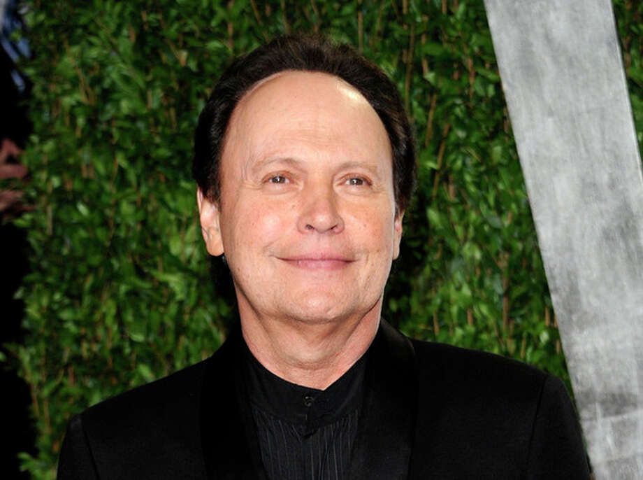 FILE - This Feb. 26, 2012 file photo shows Billy Crystal arriving at the Vanity Fair Oscar party in West Hollywood, Calif. Crystal has an agreement with Henry Holt and Company for a book that will be part memoir, part meditation _ with jokes _ about getting older. The book is currently untitled, and Crystal hopes to have it out when the big day arrives, March 14, 2013. (AP Photo/Evan Agostini, file) / AGOEV