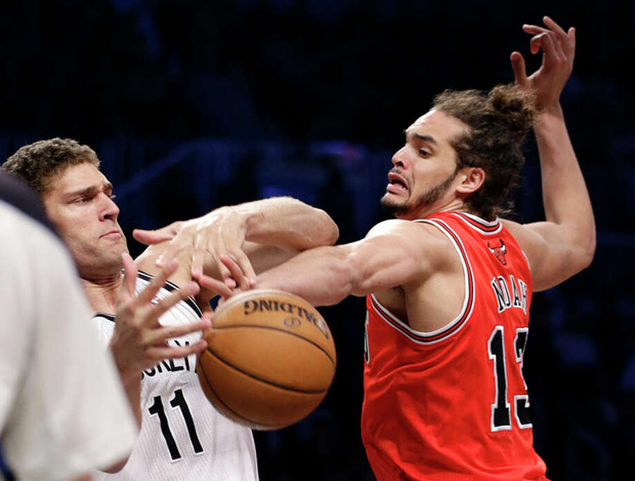 Chicago Bulls center Joakim Noah (13) steals the ball from Brooklyn Nets center Brook Lopez (11) in the first half of Game 5 of their first-round NBA basketball playoff series, Monday, April 29, 2013, in New York. (AP Photo/Kathy Willens) / AP