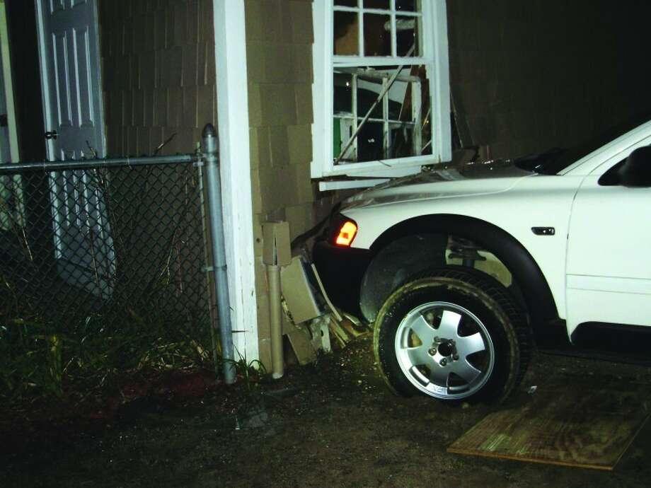 Police: Drunk driver crashes into Wilton Y building
