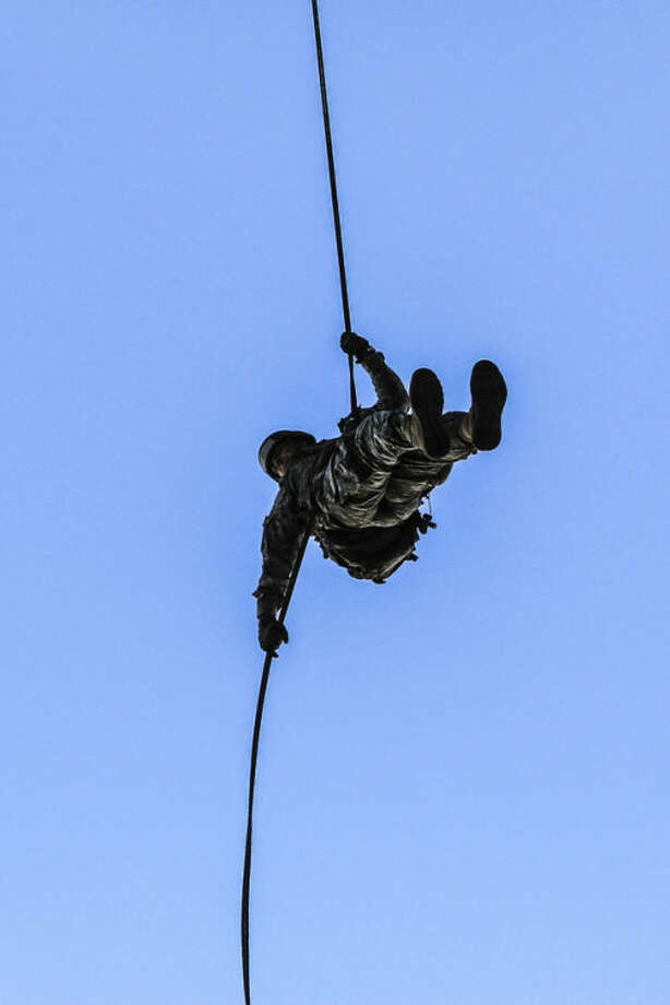 In this undated photo provided by the U.S. Army, Sgt. 1st Class Greg Robinson, an amputee, rappels from a tower at the Sabalauski Air Assault School at Fort Campbell, Ky. Robinson graduated from the 10-day course on Monday, April 29, 2013, and is the first amputee to have completed the course. (AP Photo/U.S. Army)