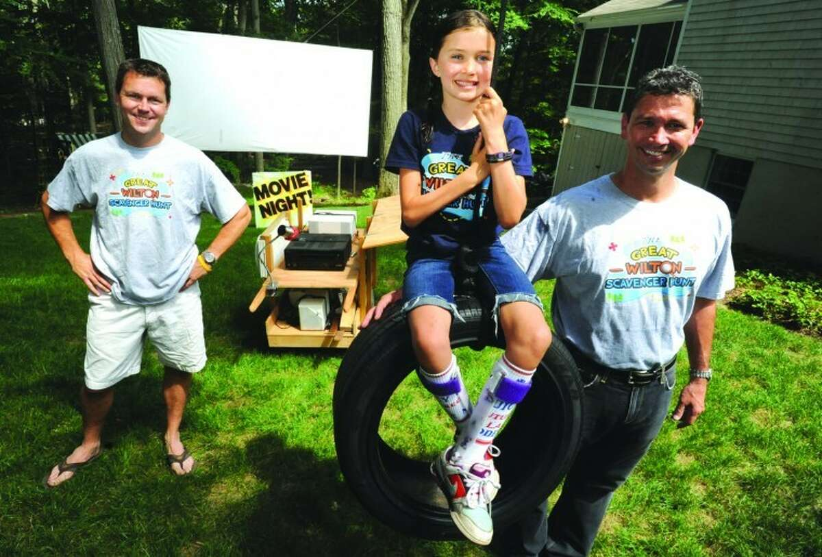 Cancer survivor Kennedy Snyder with her dad, Jeff, right. On the left is Dave Cote, who, with the Snyder family, has helped organize several fundraisers for the spinal chord cancer research. File photo/Matthew Vinci