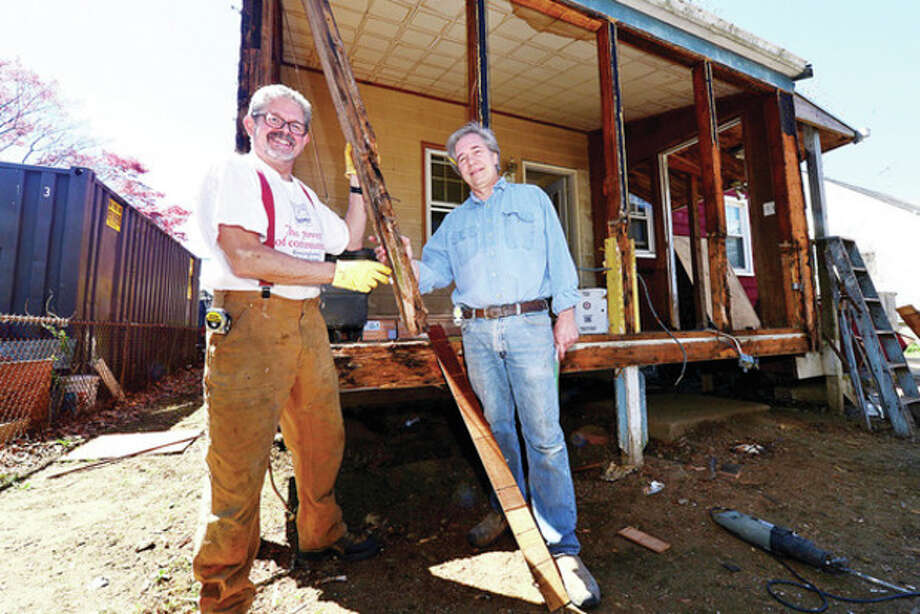 Wilton residents Kevin Craw and Bob Parisot will be working at a home on Baxter St in Norwalk with a team of locals from the volunteer home-repair program Homefront.Hour photo / Erik Trautmann / (C)2013, The Hour Newspapers, all rights reserved
