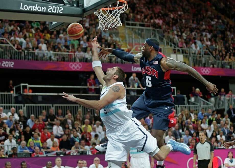 USA's Lebron James (6) fouls Argentina's Juan Gutierrez on a drive to the basket during a men's basketball game at the 2012 Summer Olympics, Monday, Aug. 6, 2012, in London. (AP Photo/Charles Krupa) / AP