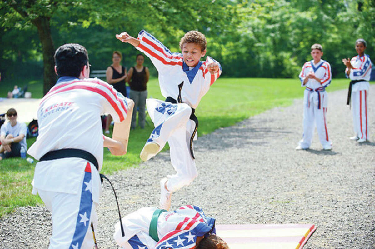 """Hour photos / Erik Trautmann Above, Jeremy Cooke participates in the """"Kicks for Kids"""" fundraiser sponsored by Karate Universe to help fight diabetes at Merwin Meadows in Wilton. Below, Gavin Fusco participates."""