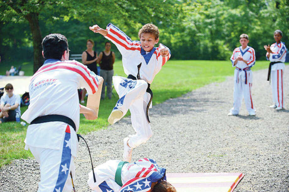 "Hour photos / Erik TrautmannAbove, Jeremy Cooke participates in the ""Kicks for Kids"" fundraiser sponsored by Karate Universe to help fight diabetes at Merwin Meadows in Wilton. Below, Gavin Fusco participates. / (C)2012, The Hour Newspapers, all rights reserved"
