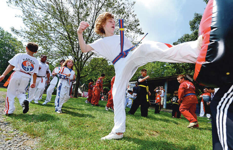"Hour photo / Erik TrautmannNicholas Savano participates during the ""Kicks for Kids"" fundraiser sponsored by Karate Universe to help fight diabetes recently at Merwin Meadows in Wilton. / (C)2012, The Hour Newspapers, all rights reserved"