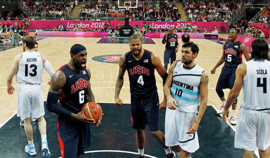 Lebron James, left, of the U.S. and teammate Tyson Chandler, center, yell as Argentina's Carlos Delfino, right, was called for a foul during their men's preliminary round basketball match at the 2012 Summer Olympics on Monday, Aug. 6, 2012, in London. (AP Photo/Mike Segar, Pool) / Pool Reuters