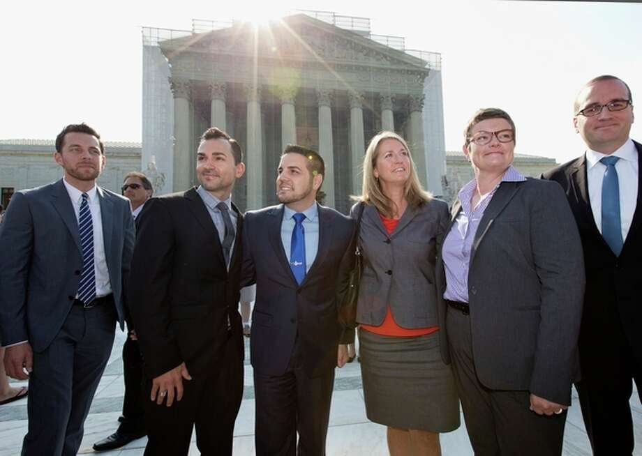 Arriving at the Supreme Court in Washington, Wednesday, June 26, 2013, on a final day for decisions in two gay marriage cases are plaintiffs in the California Proposition 8 case. From left are, Adam Umhoefer, executive director of the American Foundation for Equal Rights, plaintiffs Paul Katami, his partner Jeff Zarrillo, Sandy Stier and her partner Kris Perry, and Chad Griffin, president of the Human Rights Campaign. (AP Photo/J. Scott Applewhite) / AP