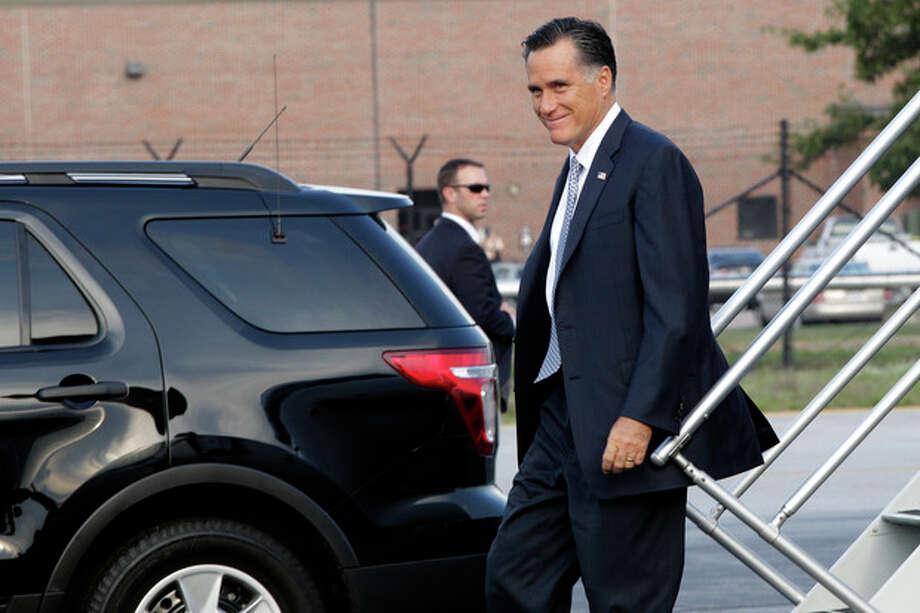 Republican presidential candidate, former Massachusetts Gov. Mitt Romney arrives in in Bedford, Mass., Thursday, Aug. 9, 2012. (AP Photo/Mary Altaffer) / AP