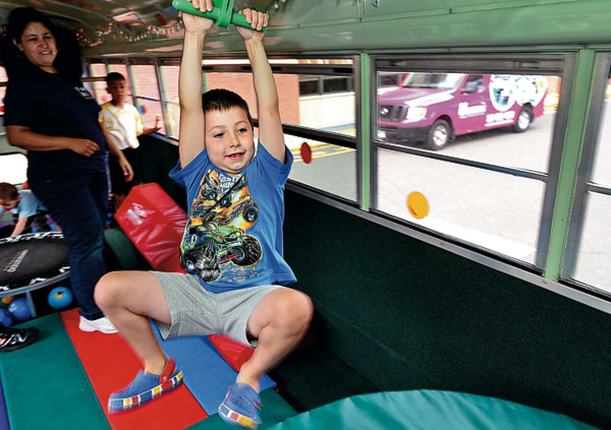 Lorenzo Terenzio, 6, plays in the Fun Bus Friday when the mobile gymnasium came to the Norwalk Public Library courtesy of the library's children's department. Hour photo / Erik Trautmann