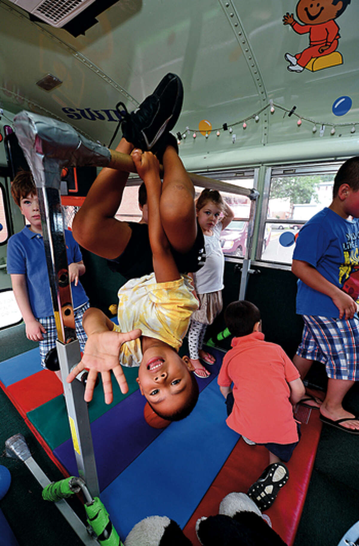 Christian Young, 5, plays in the Fun Bus Friday when the mobile gymnasium came to the Norwalk Public Library courtesy of the library's children's department. Hour photo / Erik Trautmann