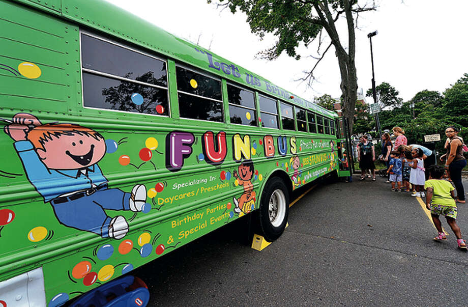 Children line up to play in the Fun Bus Friday when the mobile gymnasium came to the Norwalk Public Library courtesy of the library's children's department. Hour photo / Erik Trautmann / (C)2012, The Hour Newspapers, all rights reserved