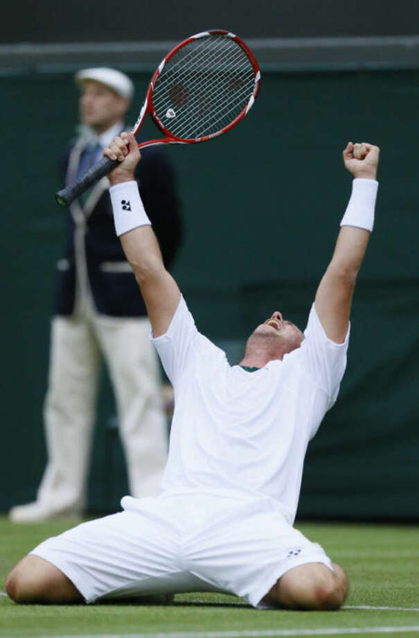 Lleyton Hewitt of Australia reacts as he beats Stanislas Wawrinka of Switzerland during their Men's first round singles match at the All England Lawn Tennis Championships in Wimbledon, London, Monday, June 24, 2013. (AP Photo/Kirsty Wigglesworth)