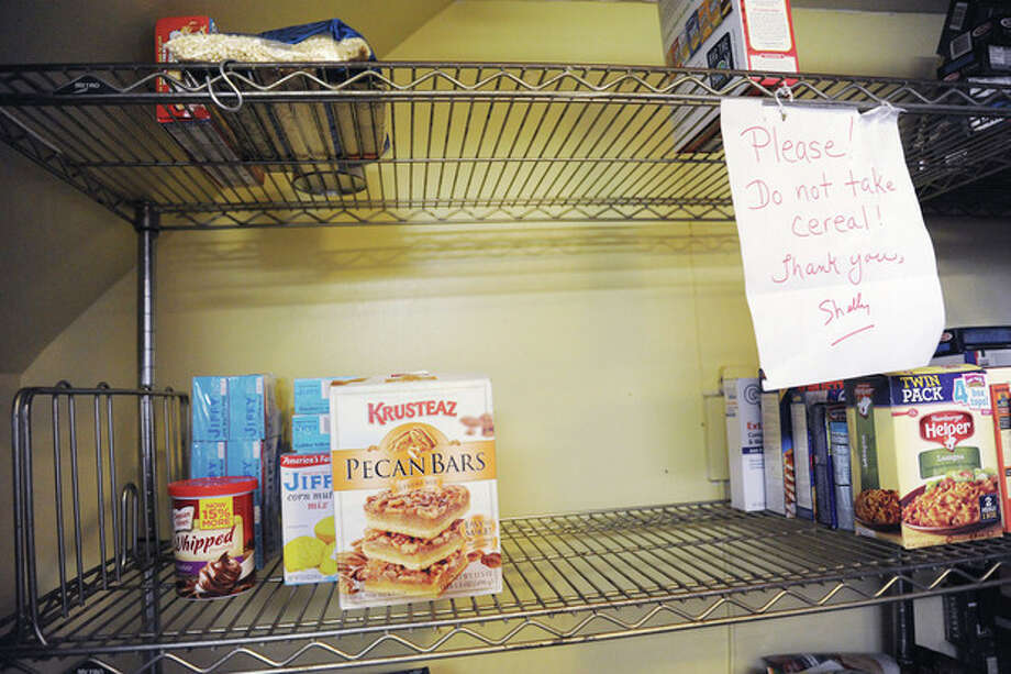 The food pantry at the Open Door Shelter is running extremely low and is in need of donations. Hour photo/Matthew Vinci