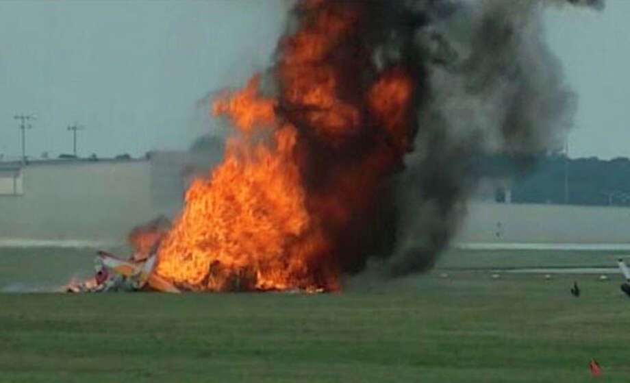 This photo provided provided WHIO TV shows a plane after it crashed Saturday, June 22, 2013, at the Vectren Air Show near Dayton, Ohio. There was no immediate word on the fate of the pilot, wing walker or anyone else aboard the plane. No one on the ground was hurt. (AP Photo/WHIO-TV) / WHIO TV
