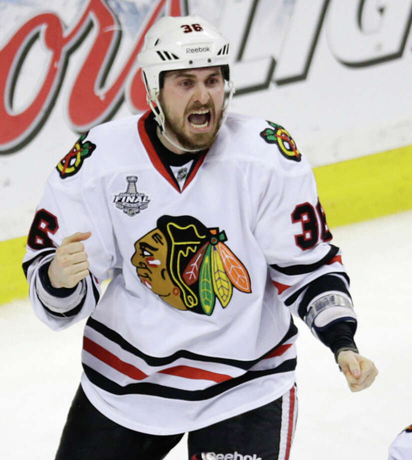 Chicago Blackhawks center Dave Bolland (36) celebrates his game winning goal against the Boston Bruins during the third period in Game 6 of the NHL hockey Stanley Cup Finals, Monday, June 24, 2013, in Boston. The Blackhawks won 3-2. (AP Photo/Charles Krupa) / AP