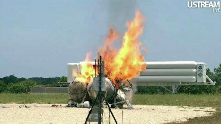 In this still image made from video provided by NASA, the methane-powered Morpheus lander burns after it crashed in a test flight at Kennedy Space Center in Florida Thursday, Aug. 9, 2012. NASA spokeswoman Lisa Malone says nobody was hurt, but it appears the prototype lander is a total loss. (AP Photo/NASA) / NASA