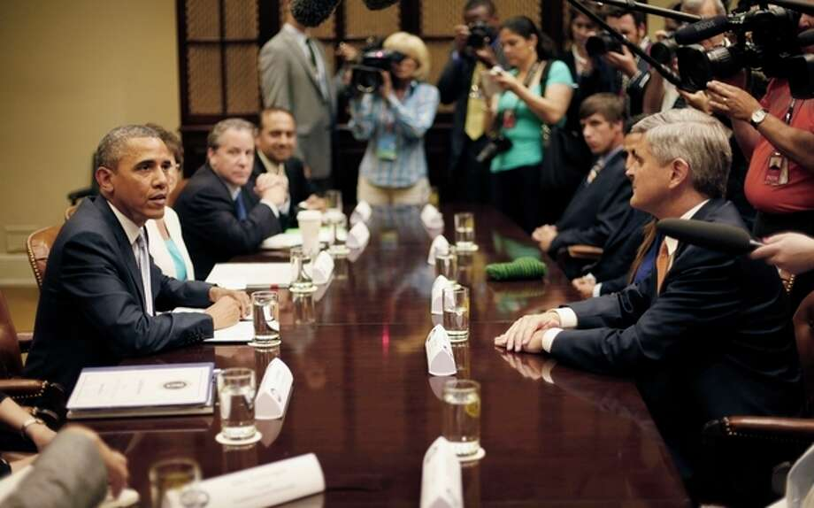 President Barack Obama, right, sit across from Steve Case, right, Chairman and CEO, Revolution LLc, and other CEOs, business owners and entrepreneurs during a meeting in the Roosevelt Room of the White House in Washington, Monday, June 24, 2013, to discuss immigration reform. Obama hosted the meeting to discuss the importance of commonsense immigration reform including the Congressional Budget Office analysis that concludes immigration reform would promote economic growth and reduce the deficit. (AP Photo/Pablo Martinez Monsivais) / AP