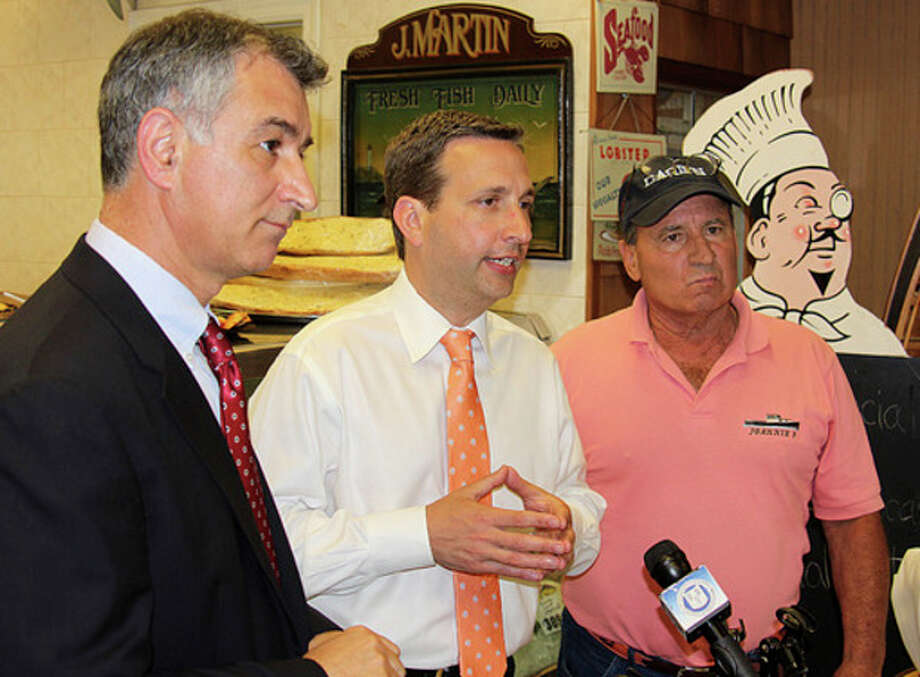 Hour photo / Chris BosakState Sen. Carlo Leone, State Sen. Bob Duff and local lobsterman Roger Frate discuss the state of the lobster population in Long Island Sound during a press conference held Monday at Darien Seafood.