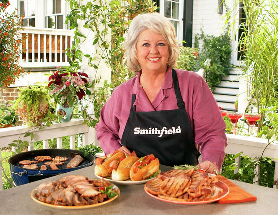 FILE - This undated image released by Smithfield Foods shows celebrity chef Paula Deen wearing a Smithfield apron as she stands in front of various Smithfield meat products. On Monday, June 24, 2013, Smithfield Foods said it was dropping Deen as a spokeswoman. The announcement came days after the Food Network said it would not renew the celebrity cook's contract in the wake of revelations that she used racial slurs in the past. (AP Photo/Smithfield Foods via PRNewsFoto) / TGPRN SMITHFIELD FOODS vis PRNewswire