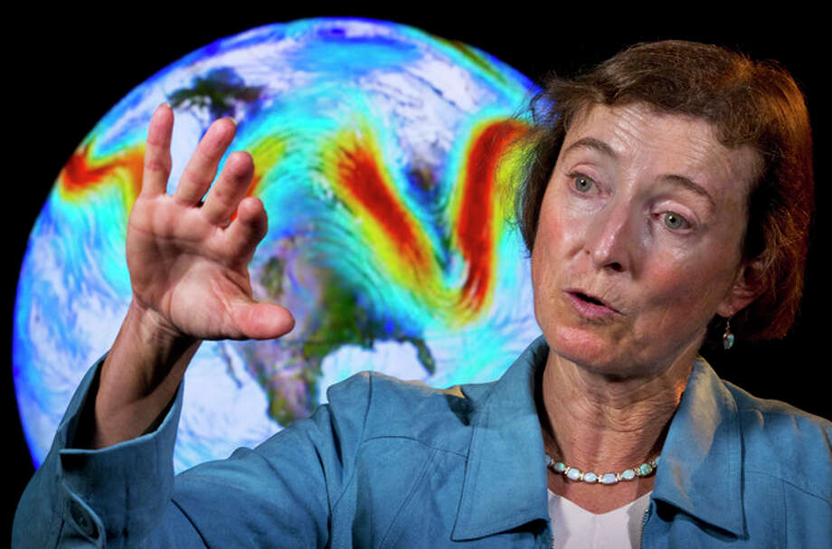 """Rutgers University Climate Scientist Jennifer Francis talks about the jet stream in front of an animation of the fast flowing air current during an interview in Washington, on Friday, June 7, 2013. """"It's been just a crazy fall and winter and spring all along, following a very abnormal sea ice condition in the Arctic,"""" Francis said, noting that last year set a record low for summer sea ice in the Arctic. """"It's possible what we're seeing in this unusual weather is all connected."""" (AP Photo/Jacquelyn Martin) / AP"""