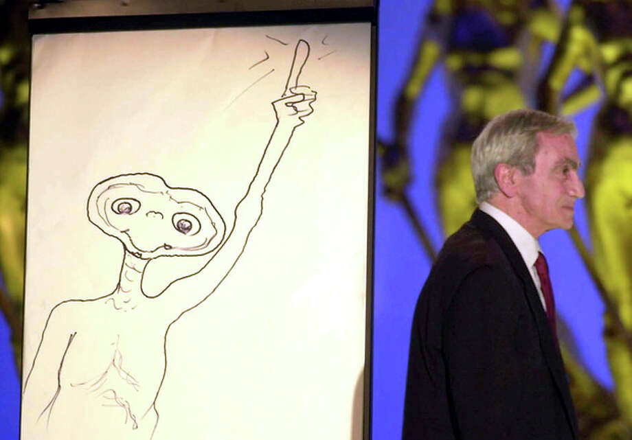 """FILE - This April 10, 2002 file photo shows special effects artist Carlo Rambaldi walking on stage after drawing a cartoon of ET during the Italian David Di Donatello cinema awards in Rome's Cinecitta' studios. Rambaldi who won three Oscars for the special effecs of """"King Kong"""" by John Guillermin, """"Alien"""" by Ridley Scott and """"E.T. the Extra-Terrestrial"""" by Steven Spielberg, died in Lamezia Terme, Italy, Friday Aug. 10, 2012. He was 86. (AP Photo/Gregorio Borgia, FILE) / AP"""