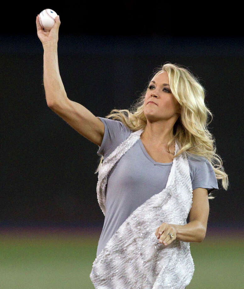 Country singer Carrie Underwood throws the ceremonial first pitch before a baseball game between the New York Yankees and the Toronto Blue Jays, Sunday, Aug. 12, 2012, in Toronto. (AP Photo/The Canadian Press, Chris Young) / The Canadian Press