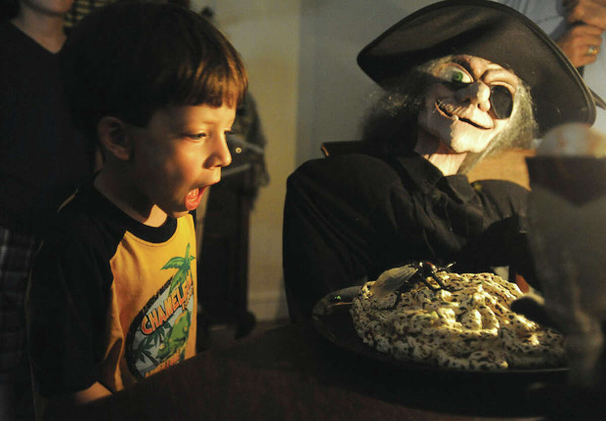 Hour photo / Matthew Vinci William Manha 5, gets a scare Sunday at the Norwalk Seaport Association's Haunted Lighthouse tour.