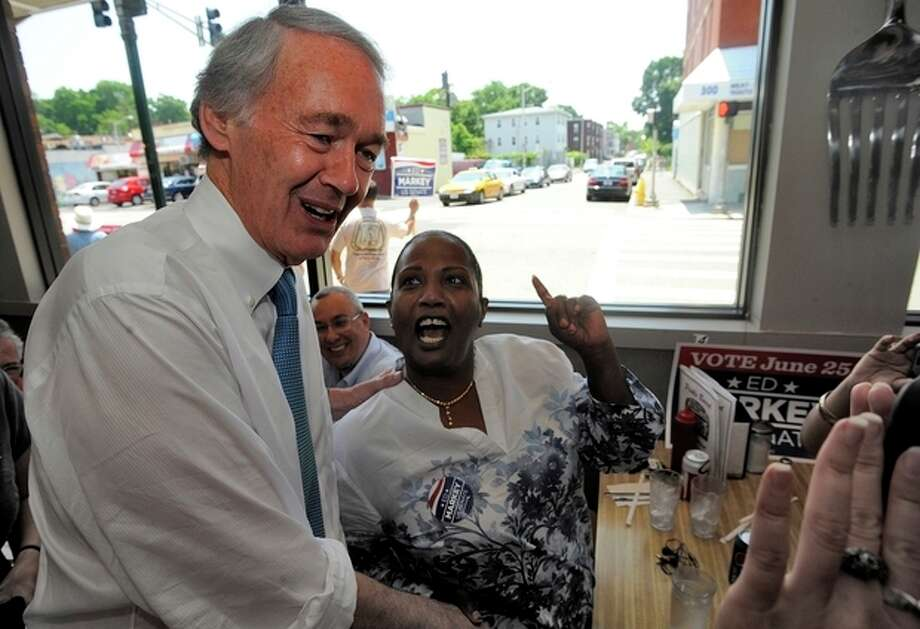 Massachusetts Senate Democratic candidate Ed Markey, left, meets and greets grassroots volunteers and supporters at the Pickle Barrel Restaurant & Deli, in Worcester, Mass., Monday, June 24, 2013. Markey and Republican Gabriel Gomez made appeals to voters Monday in the final hours before Massachusetts' special election for the U.S. Senate, where turnout is expected to be light, a contrast to the high-profile special election in the state three years ago. (AP Photo/Worcester Telegram & Gazette, John Ferrarone) / Worcester Telegram & Gazette