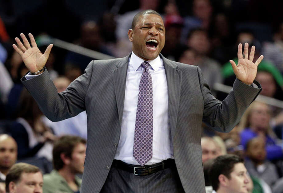 FILE - In this Feb. 11, 2013 file photo, Boston Celtics head coach Doc Rivers reacts to a call during the first half of an NBA basketball game against the Charlotte Bobcats in Charlotte, N.C. Rivers will be the next coach of the Los Angeles Clippers if the NBA approves the rare but not unprecedented trade of an active coach, a Boston Celtics official told The Associated Press on Sunday night, June 23, 2013. (AP Photo/Chuck Burton, File) / AP
