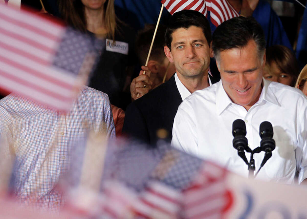AP Photo/Pablo Martinez Monsivais Republican presidential candidate, former Massachusetts Gov. Mitt Romney, right, with his newly announced vice presidential running mate, Rep. Paul Ryan, R-Wis., standing behind him, during a campaign rally in Manassas, Va., Saturday, Aug. 11.