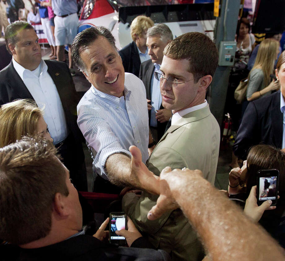 Republican presidential candidate Mitt Romney, center, greets supporters at a rally Sunday, Aug. 12, 2012, in Mooresville, N.C., at the NASCAR Technical Institute. (AP Photo/Jason E. Miczek) / AP