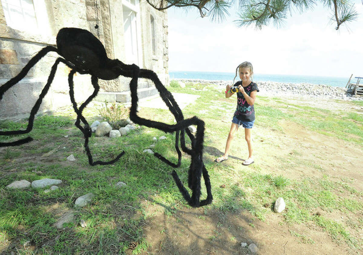 Hour photo / Matthew Vinci Lucia Schirring 8, takes a big spider photo Sunday at the Norwalk Seaport Association's Haunted Lighthouse..