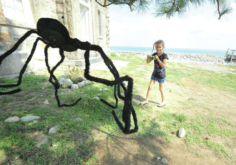 Hour photo / Matthew VinciLucia Schirring 8, takes a big spider photo Sunday at the Norwalk Seaport Association's Haunted Lighthouse..