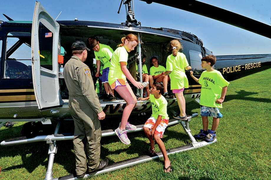DARE campers tour a police helicopter at Taylor Farm Park Tuesday as part of the Norwalk police summer camp. Hour photo / Erik Trautmann / (C)2013, The Hour Newspapers, all rights reserved