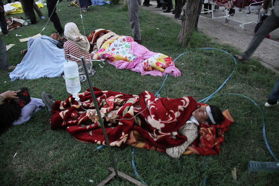 Victims lie injured at the courtyard of a hospital after an earthquake in the city of Ahar in northwestern Iran, on Saturday, Aug. 11, 2012. A 6.2-magnitude earthquake hit the towns of Ahar, Haris and Varzaqan in East Azerbaijan province in northwestern Iran on Saturday, state TV said. Iran is located on seismic fault lines and is prone to earthquakes. It experiences at least one earthquake every day on average, although the vast majority are so small they go unnoticed. (AP Photo/Fars News Agency, Kamel Rouhi) / Fars News Agency