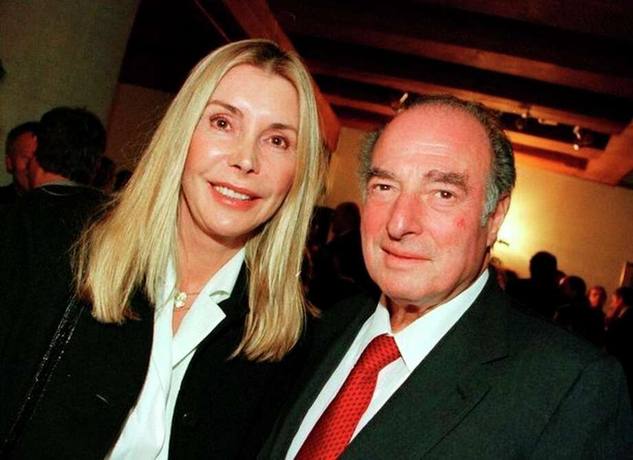 FILE - This is a Nov. 27, 2000. file photo of Marc Rich and his wife Gisela as they pose during an award ceremony at the city hall in Zug, central Switzerland. An associate of Marc Rich said Wednesday June 26, 2013, that the trader pardoned by President Clinton has died in Switzerland.(AP Photo/Urs Flueeler, File) NO SALES TV OUT / KEYSTONE
