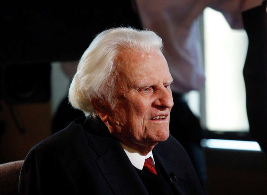 FILE - In this Dec. 20, 2010 file photo, evangelist Billy Graham speaks to the media at the Billy Graham Evangelistic Association headquarters in Charlotte, N.C. A spokesman for Graham says the 93-year-old evangelist has been admitted to a North Carolina hospital for an infection in his lungs. A joint statement Sunday, Aug. 12, 2012, from Graham's spokesman and Mission Hospital says Graham was admitted overnight for evaluation and treatment of an infection thought to be bronchitis. The hospital is in Asheville, near his home in Montreat. (AP Photo/Nell Redmond, File) / FR25171 AP