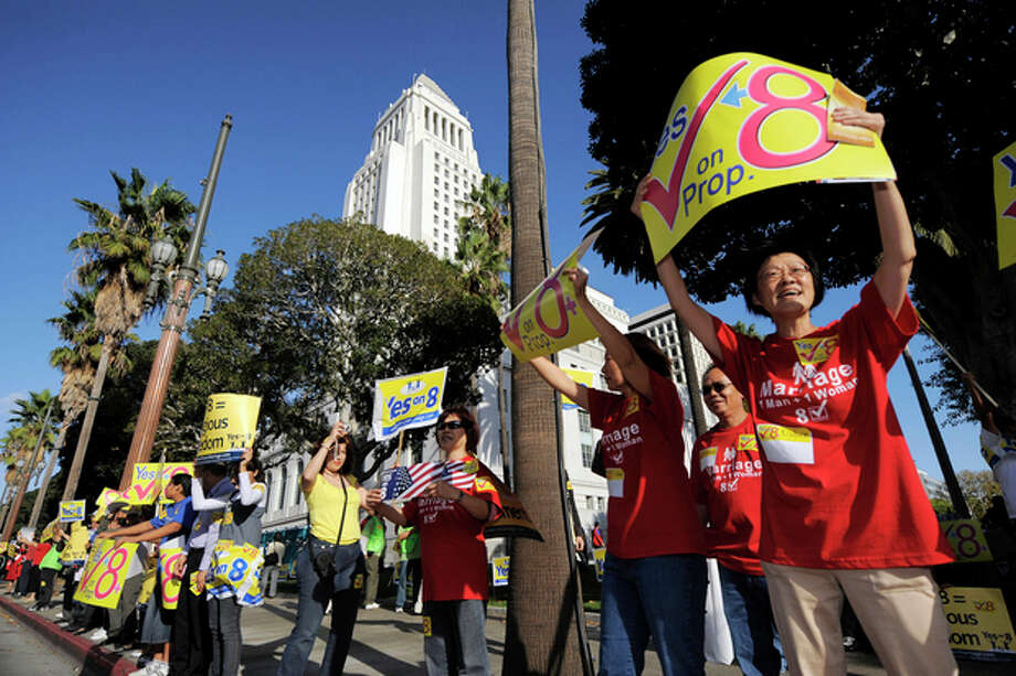 FILE - This Nov. 2, 2008 file photo shows supporters of Proposition 8, the state's measure that banned same sex marriages, in front of city hall during a Yes on Prop. 8 rally in Los Angeles. The U.S. Supreme Court is expected to issue a ruling that will determine the fate of California's voter-approved ban on same-sex marriages on Wednesday morning, June 26, 2013. (AP Photo/Mark J. Terrill, File) / AP