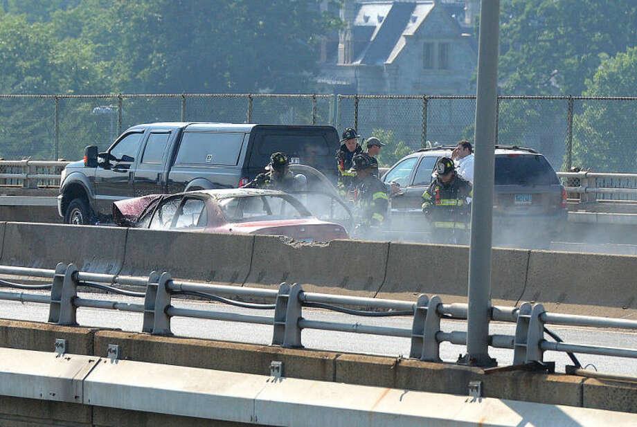 Hour Photo/Alex von Kleydorff . Car on Fire on I 95 Southbound on the Yankee Doodle Bridge