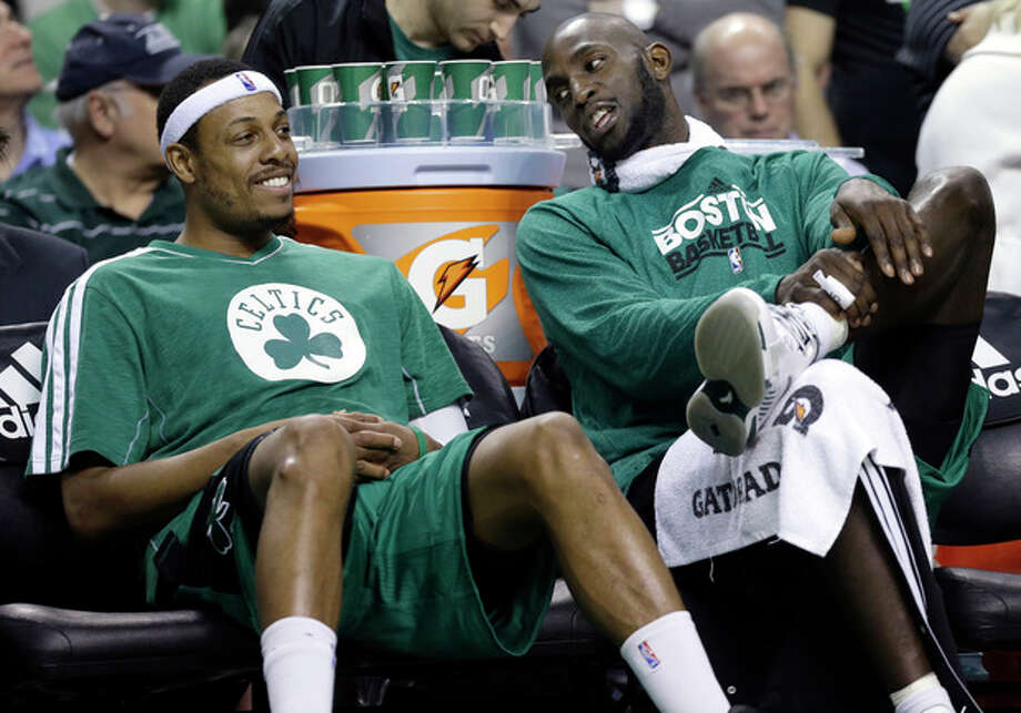 FILE - Boston Celtics center Kevin Garnett, right, chats with teammate Paul Pierce on the bench during the fourth quarter of an NBA basketball game against the Toronto Raptors in Boston, in this March 13, 2013 file photo. The Brooklyn Nets will acquire Paul Pierce and Kevin Garnett from the Boston Celtics in a deal that was still developing as the NBA draft ended, according to a person with knowledge of the details. The trade can't be completed until July 10, after next season's salary cap is set, so pieces were still being discussed early Friday June 28, 2013. (AP Photo/Elise Amendola, File) / AP