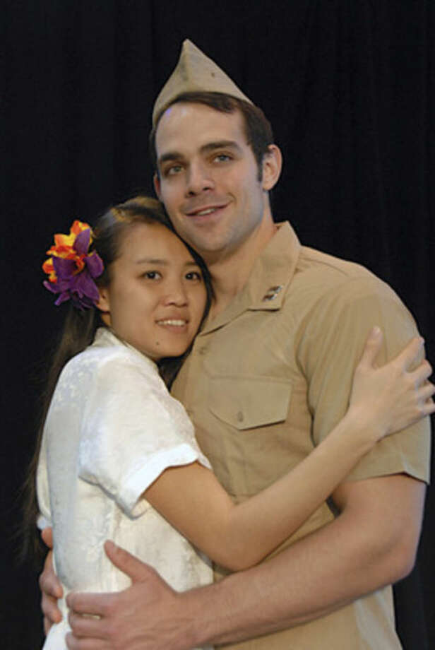 Kim Wong (Liat) and Jason Michael Evans (Lt. Joe Cable) in in The Summer Theatre of New Canaan's production of SOUTH PACIFIC, Thru July 13, Waveny Park, New Canaan.