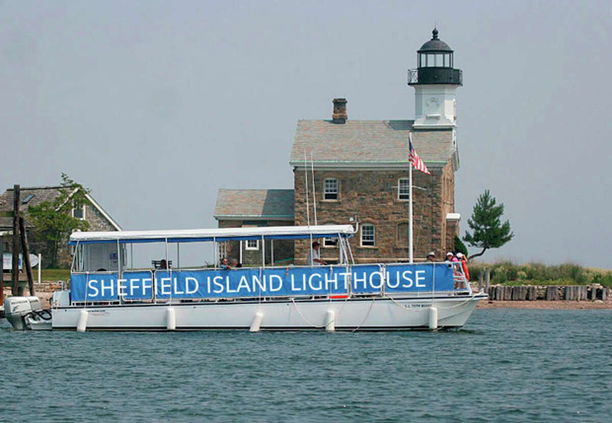 Contributed photo Norwalk Seaport Association's C.J. Toth in front of the Sheffield Island Lighthouse on Sheffield Island, one of the Norwalk Islands.